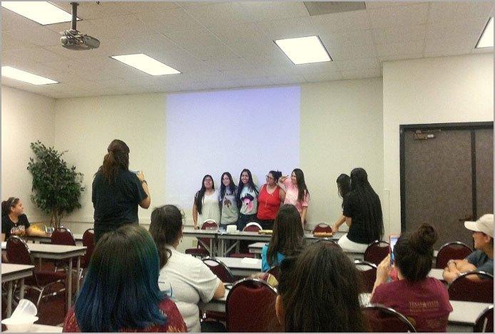 Members discuss recent ICE raids at Latinas Unidas meeting Feb. 23.